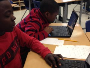 5th grade students use Chromebooks to research tides.
