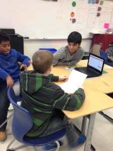 Students work together to prepare for their tides presentation to the class.