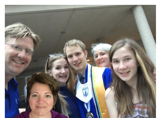 Selfie overlaid onto someone else's graduation photo.
